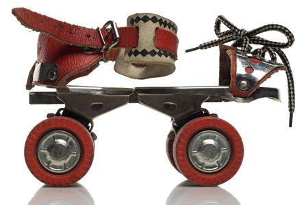 rollerskates: a vintage roller skate on white background