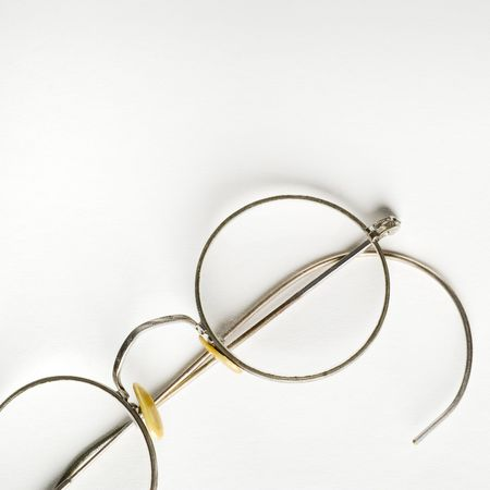 rimmed: a pair of rimmed glasses on white paper Stock Photo