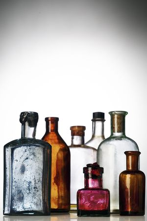 six old, dirty pharmacists bottles photo