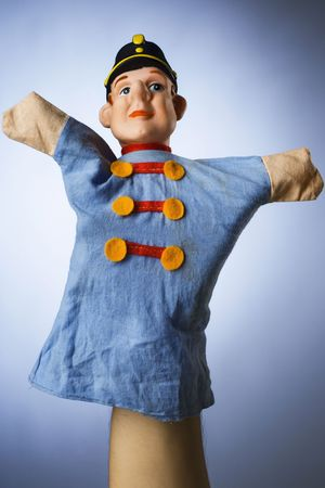 amusment: toy hand puppet against blue background