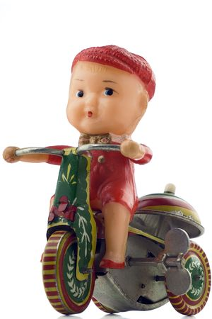 windup: tin windup toy - boy riding bicycle