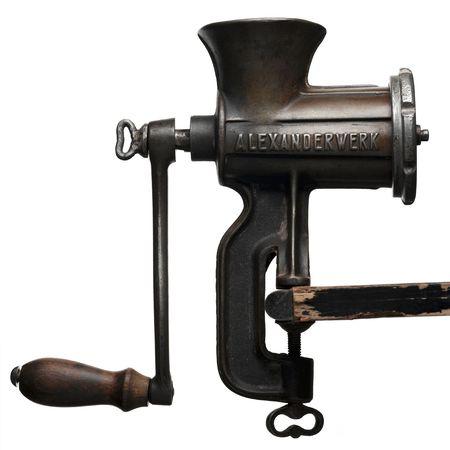 grinder machine: meat grinder against white background