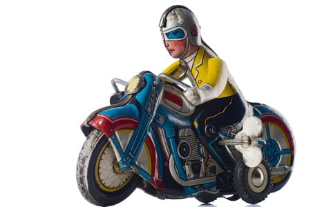 windup: a windup tin toy - motorcyclist