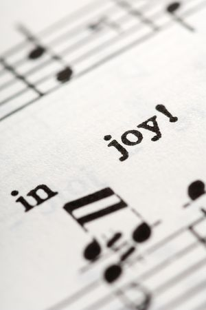 hymn: a detail from the hymnal with the words: In Joy