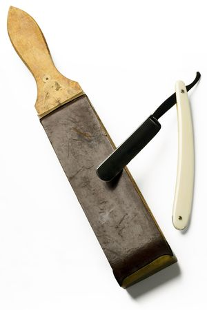 a shaving razor and a sharpening leather on white photo