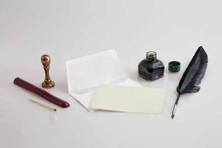 hallmark: Paper with envelope, quill pen, inkwell and seal Stock Photo