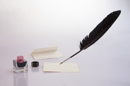 cachet: Paper with envelope, quill pen, inkwell and seal Stock Photo
