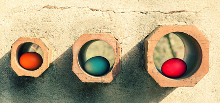 Three easter eggs in walls holes photo