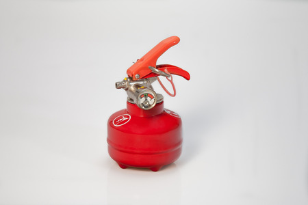 Small or pocket fire-extinguisher mashine with red color photo