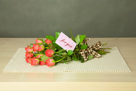 bouguet of roses with card with for you text photo