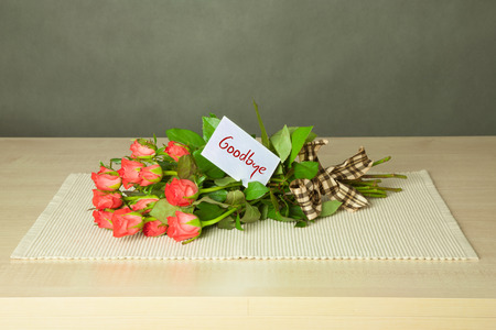 bouguet of roses with card with goodbye text