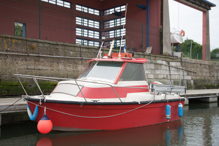 waterway: Floating small motorboat Stock Photo