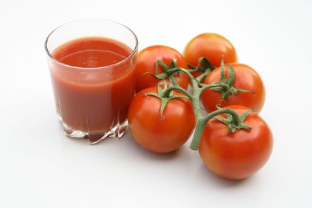 tomatoes and juice on the white background