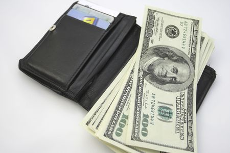 wallet and money on the white background Stock Photo