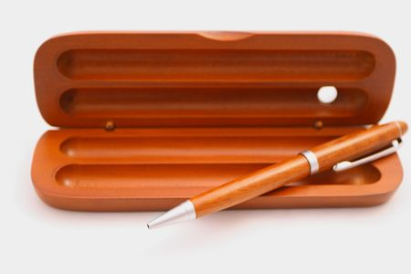 pen and box on the white background