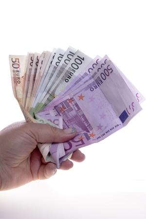 hand holds money euro on the white background Stock Photo