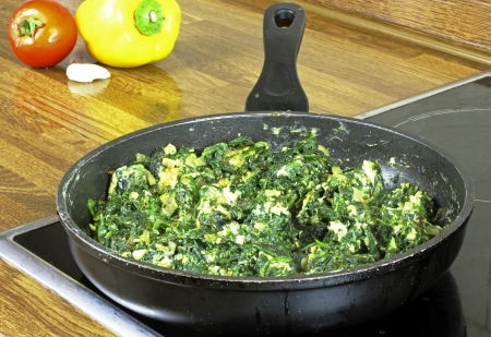 rosated spinach with eggs Stock Photo