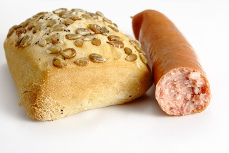 roll bread and sausage on the white background