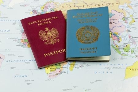 ethnic polish emigrant   Passports on the map Stock Photo