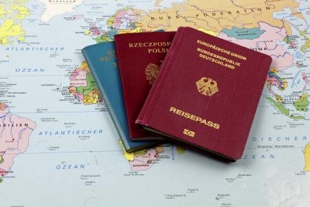 ethnic German emigrant   Passports on the map Stock Photo