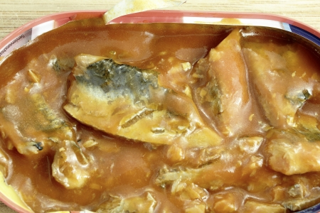 close up of herring in tomato souce