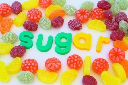 candies around word sugar Stock Photo