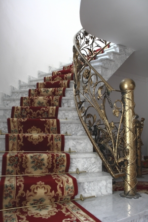 marble stairs and gold balustrade Stock Photo