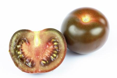 kumato tomaten on the white background Stock Photo