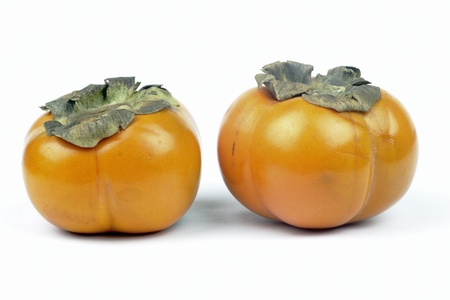 Persimmons on the white background Stock Photo