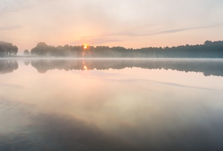 on lake: Beautiful sunrise over lake with reflections in water