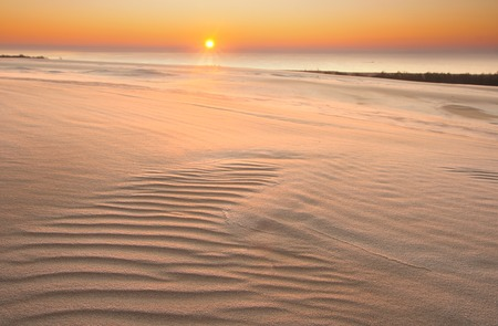 Sand dunes at sunrise, photographed in Slowinski National Park in Poland photo