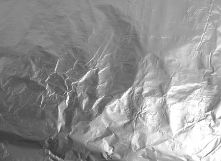 Color texture of creased kitchen aluminum foil photo