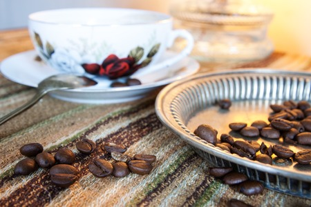 decaffeinated: coffee beans on wooden table and old equipment