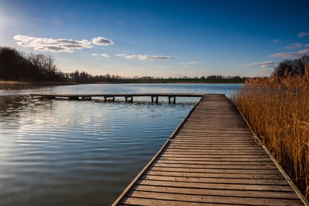 rural countryside: Beautiful polish lake landscape, tranquil rural countryside at springtime Stock Photo
