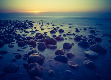 Beautiful seascape of Baltic sea rocky shore. Photo with vintage mood. photo