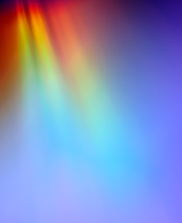 Closeup of rainbow colored reflection on CD, useful as background