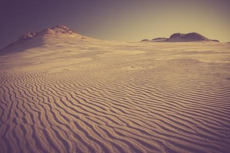 Sand dunes landscape in Slowinski National Park in Poland. Photo with vintage mood
