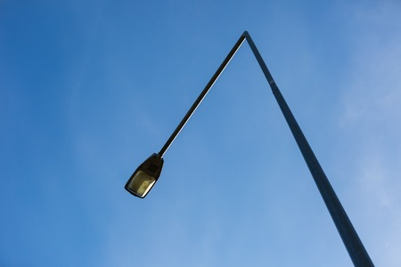 Street lamp on blue sky background photographed at middle of the day. photo