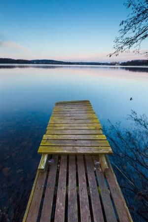 long lake: Small pier on lake, long exposure photo. Mazury lake district.