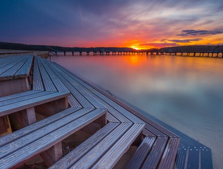 Beautiful lake landscape with vibrant sunset. Long exposure landscape. photo