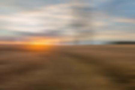 Blurry, defocused field landscape useful as background. Out of focus landscape. photo