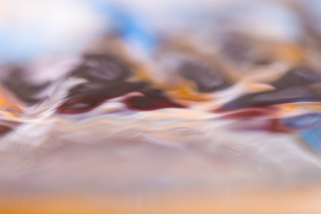 colorful water surface: Colorful moving liquid abstract. Close up of moving water surface.