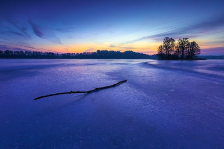 Frozen lake at sunrise landscape. Beautiful landscape of winter lake in Mazury lake district. photo