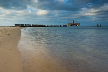 breakwaters: Beautiful view on Baltic sandy coast with old military buildings from world war II and wooden breakwaters.