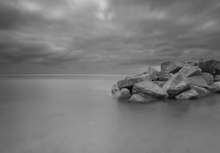 stony: Beautiful seascape with stony breakwater photographed on long exposure.