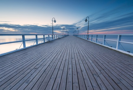 morning blue hour: Beautiful pier in Gdynia, poland. Seascape with wooden molo in Orlowo. Landscape photographed before sunrise