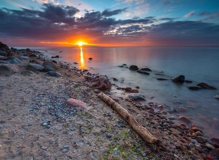 Beautifu rocky sea shore at sunrise or sunset. Long exposure landscape. Baltic sea near Gdynia in Poland. photo