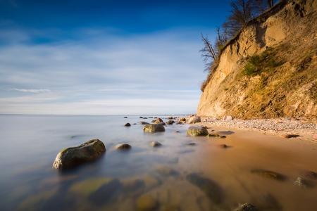 Beautiful Baltic sea shore with big cliff in Gdynia Orlowo. Seashore long exposure photo. photo