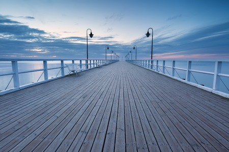 Beautiful long exposure seascape with wooden pier. Pier in Orlowo, Gdynia in Poland. Stock Photo