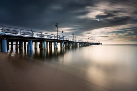 Beautiful long exposure seascape with wooden pier. Pier in Orlowo, Gdynia in Poland. photo